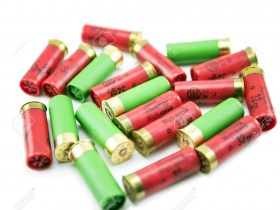 39560688-12-gauge-shotgun-shells-isolated-on-a-white-background-Stock-Photo